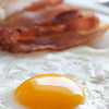 healthy breakfast with egg and bacon  on a white plate with very shallow depth of field.