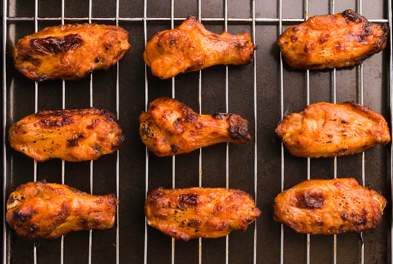 cooked fresh chicken wings on a grill