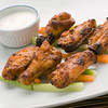 chicken buffalo wing with blue cheese sauce on a white plate