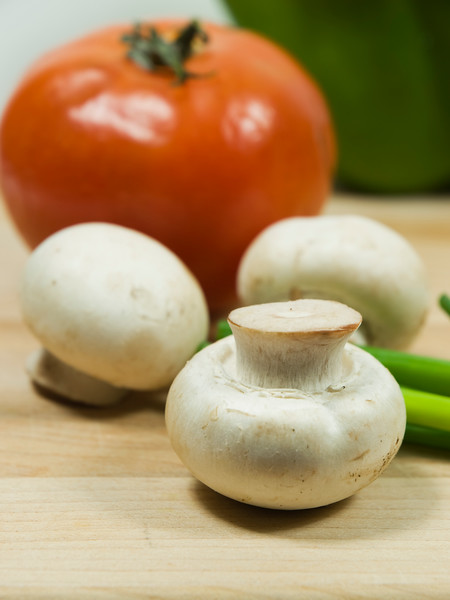 fresh mushroom with tomato on the background