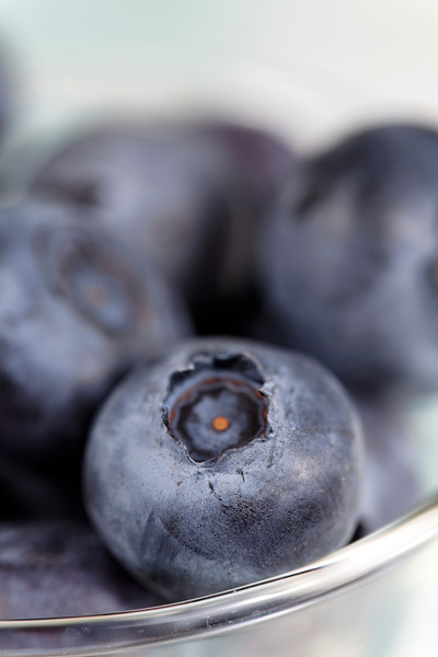 blueberry fruit in glass with very shallow depth of field. Macro photography.