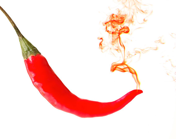 red hot pepper with smoke on a white background