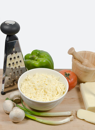 pizza ingredient on a wooden cutting board with isolated white background