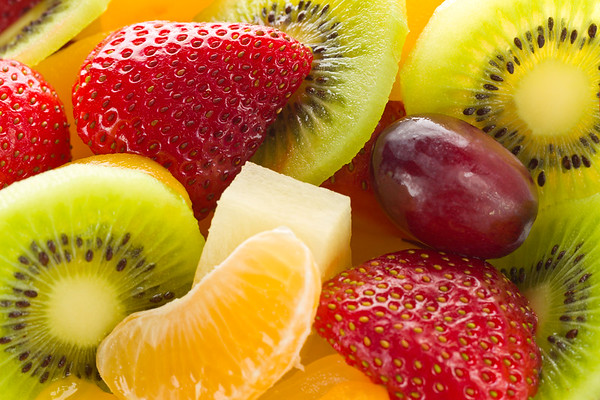 Fruit salad desert macro photo.<br /> <br /> Orientation : horizontal<br /> Concept and idea : health,healthy food, breakfast,freshness and bio.