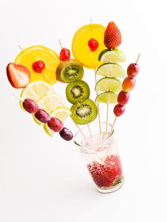 high-key color  photo of various fruit on a glass
