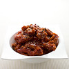 General tso chinese chicken meal on white.