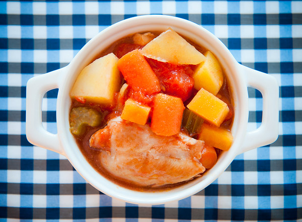 Chicken stew meal in a bowl with white meat,tomato,potato and other vegetables. Shallow depth of field.