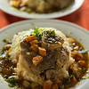Osso buco meal with sauce, mashed potato and carrot vegetable. Very shallow depth of field.