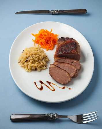 Sliced duck meat with rice and carrot vegetable.