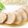 cooked loin of pork on a white plate with maple syrup sauce. Shallow depth of field.