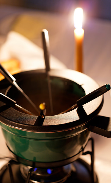 photography with meat fondue dish  on a table. Very shallow depth of field.
