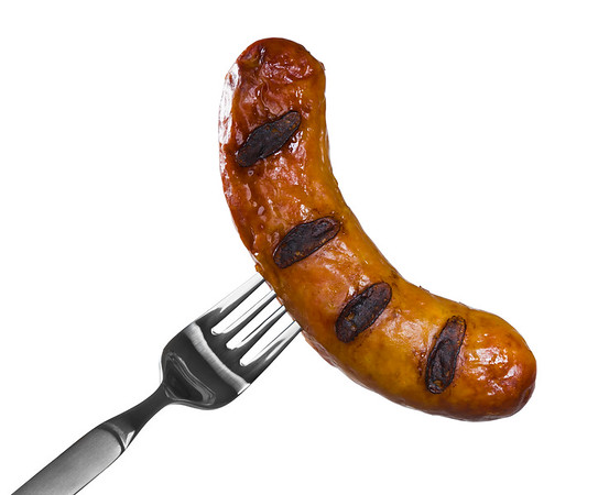 Pork sausage with fork isolated on a white background. Clipping path.