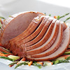 sliced baked ham on a plate with vegetable. Pork meat. Shallow depth of field.