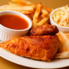 Roast chicken quarter breast with french fries, cole slaw salad and bbq sauce on the side. Shallow depth of field.
