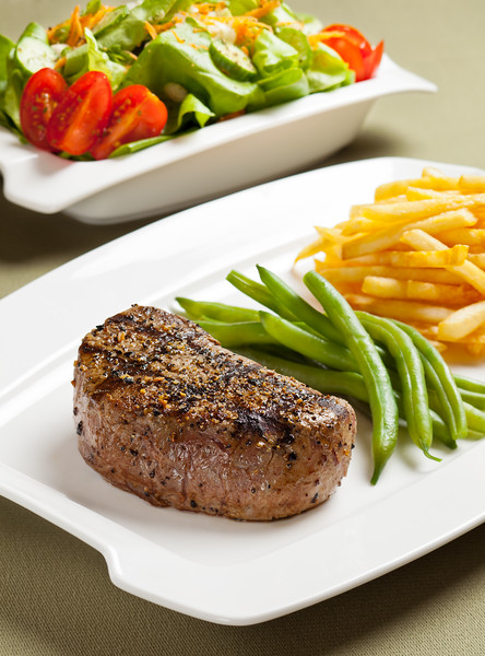 Steak with vegetable and french fries.