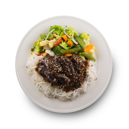 Isolated teriyaki beef meal with rice vermicelli and vegetable on a white background.