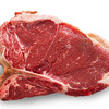 Raw t-bone or porterhouse cut meat isolated on a white background with added shadow. Clipping path into the file.