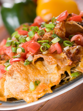 nachos with  pepper vegetable in the background.Shallow depth of field.