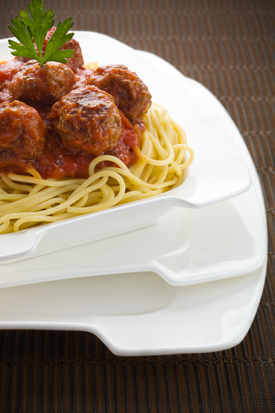 Spaghetti bolognese with beef meatball on the top.
