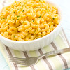 Macaroni and cheese meal in a white bowl. Shallow depth of field.