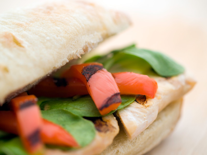 ciabatta sandwich with grilled chicken breast, lettuce and grilled red pepper. Very shallow depth of field