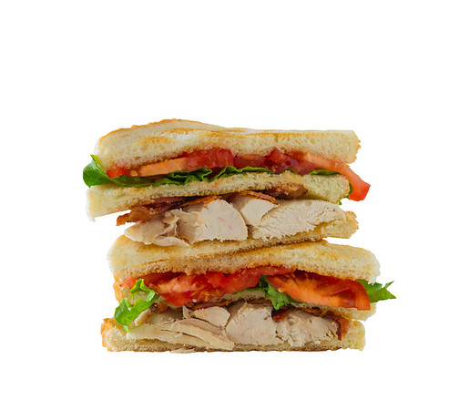 Chicken club sandwich isolated on a white background. Clipping path in the file.