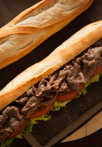 Close up shot of a beef meat sandwich. Low key image.