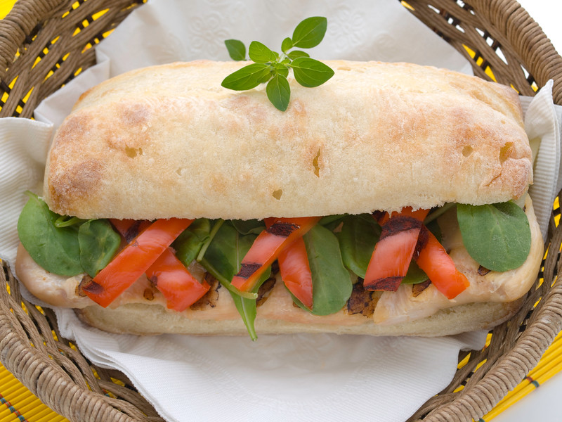 ciabatta sandwich with grilled chicken breast, lettuce and grilled red pepper
