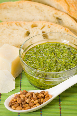Pesto sauce with pine nut, parmesan cheese and bread. Healthy eating. Shallow depth of field.