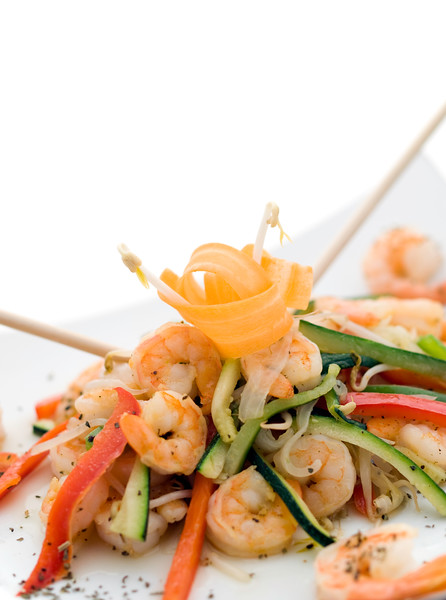stir fry vegetables with shrimps and carrot on the top. Delicious and healthy meal.shallow depth of field.
