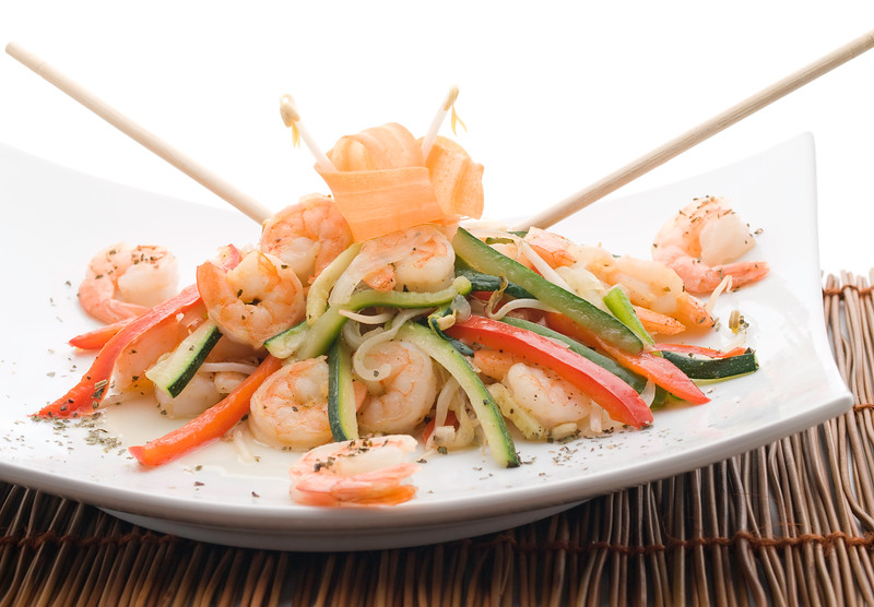 stir fry vegetables with shrimps and carrot on the top. Delicious and healthy meal.