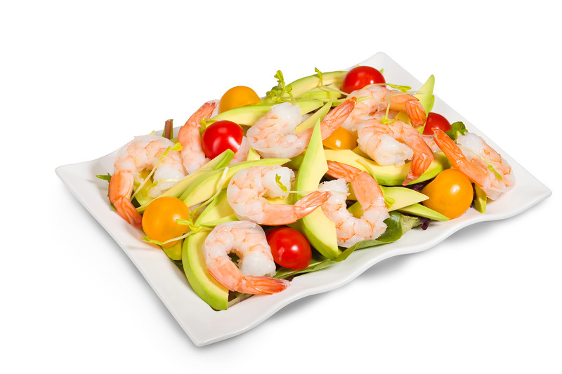 Green salad with avocado, shrimp and cherry tomato. Isolated on a white background with a  clipping path.