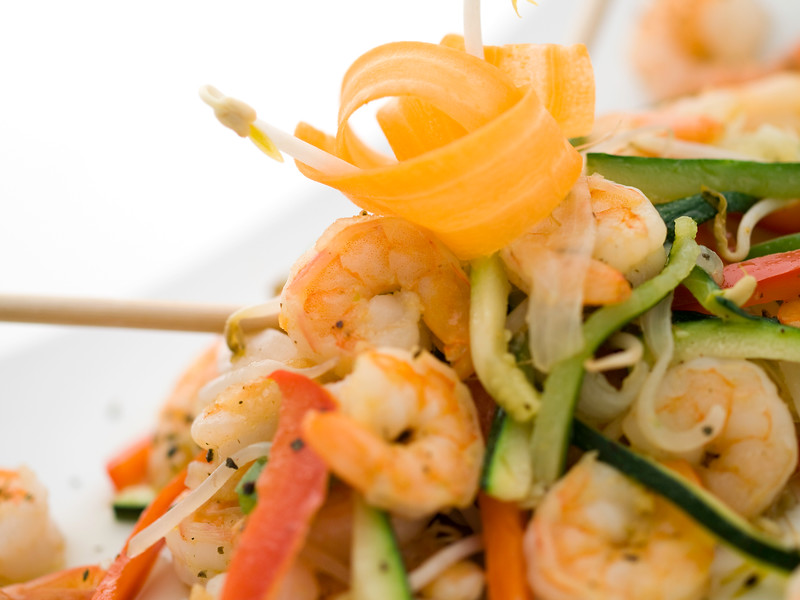 stir fry vegetables with shrimps and carrot on the top. Delicious and healthy meal.Shallow depth of field