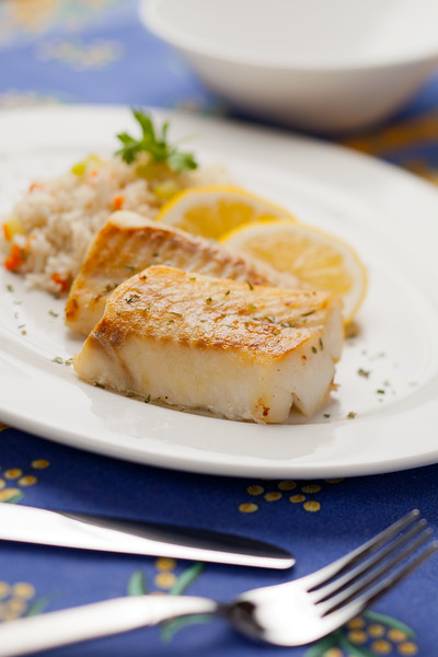 Fresh cooked cod fish with rice and lemon