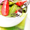 Fresh garden salad in a bowl with tomato, cucumber,lettuce,onion and carrot. Shallow depth of field.