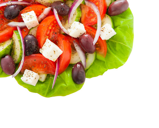 Fresh and healthy greek salad isolated on white background with clipping path. Space to add your text.