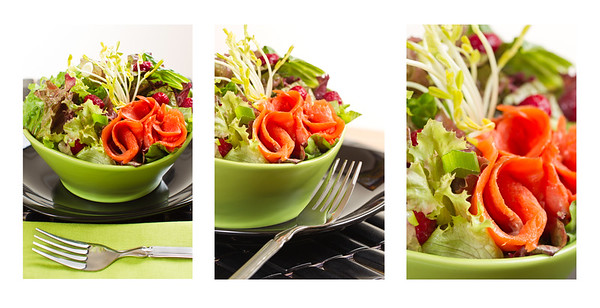 composition of fresh smoked salmon sockeye salad with lettuce and vegetable. Shallow depth of field.