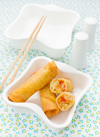 Spring roll in a white bowl.