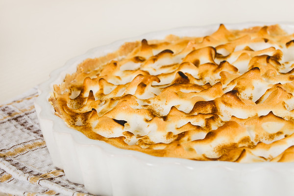 Citrus pie dessert  with meringue on the top. Very shallow depth of field.