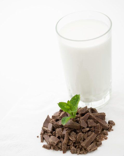 chocolate chips with mint and milk on a white background. Shallow depth of field