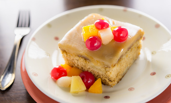 Fruit Cake dessert with real cherry,orange and peach. Very shallow depth of field.