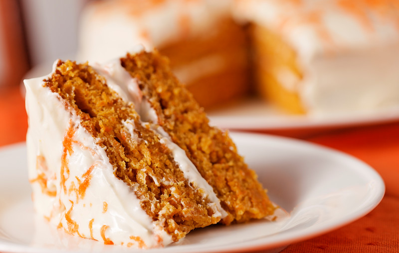 Homemade carrot cake dessert on white plate.Very shallow depth of field.