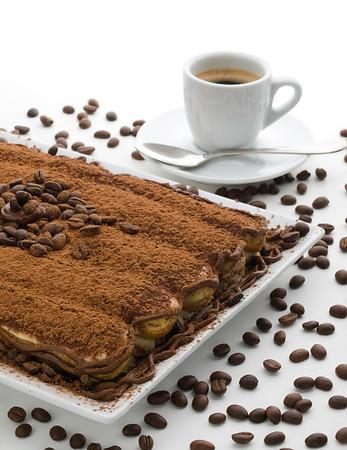 tiramisu dessert on white with coffee grain and espresso cup