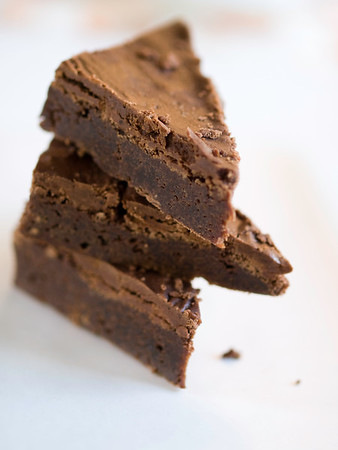 brownie dessert on white with a very shallow depth of field