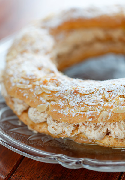 paris brest dessert on a glass plate with very shallow depth of field.