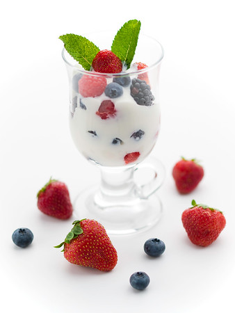 fresh fruit with yogurt.Strawberry,blueberry,berry,raspberry and mint.