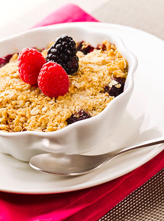 Cobbler fruit desert with fresh rasberry and berry on the top.