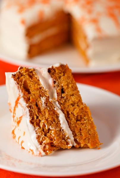 Homemade carrot cake dessert on white plate.Very shallow depth of field.