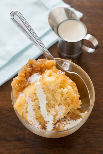 Pudding chomeur made with bread cake,caramel sauce and maple syrup. French canadian cuisine.