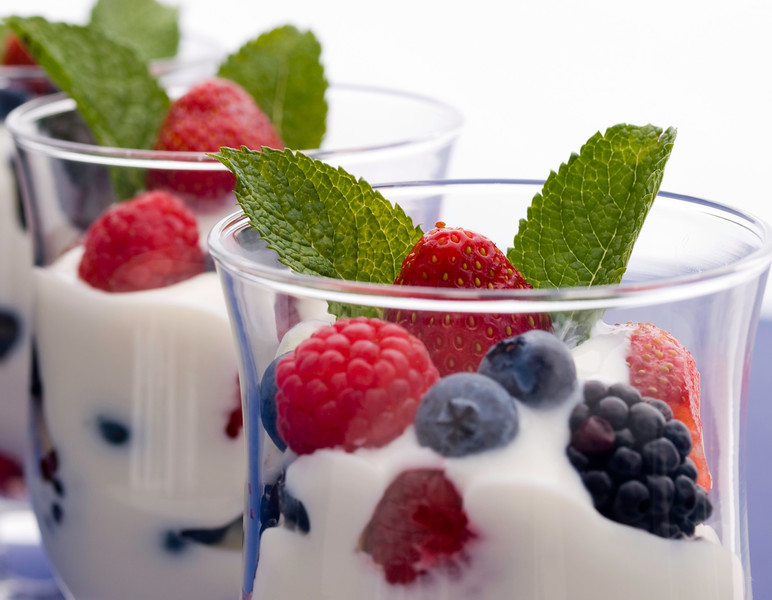 fresh fruit with yogurt.Strawberry,blueberry,berry,raspberry and mint.